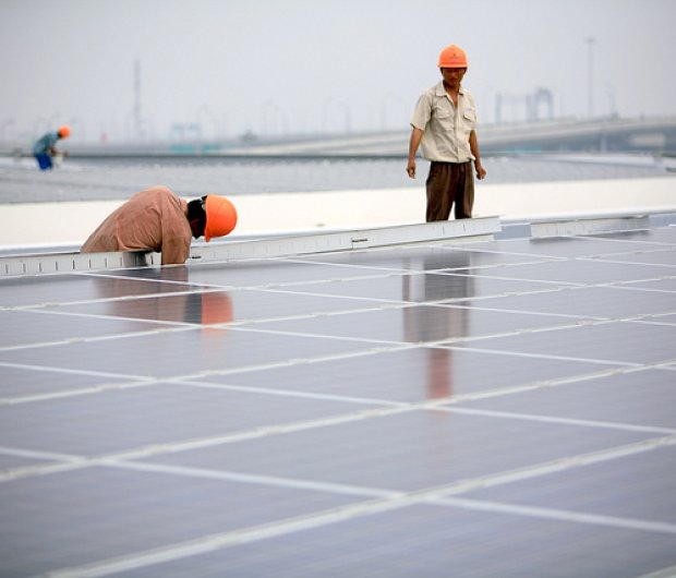 Installation of solar photovoltaic panels on the roofs of the Hongqiao Passenger Rail Terminal in Shanghai, China.  ©Jiri Rezac curtesy Flickr