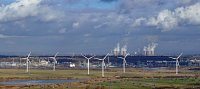 Wind turbines with the coal-powered Fiddler's Ferry power station in the background.
